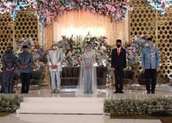 Presiden Jokowi hadir dan jadi saksi pernikahan Politisi Golkar Idris Laena di Hotel Mulia, Jakarta , Sabtu, 3 April 2021. (Foto: H. Achmad Ristanto)